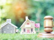 "alt=""Property auction, Model house and Gavel wooden on natural green background, lawyer of home real estate and ownership property concept"""