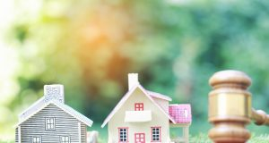 """alt=""""Property auction, Model house and Gavel wooden on natural green background, lawyer of home real estate and ownership property concept"""""""